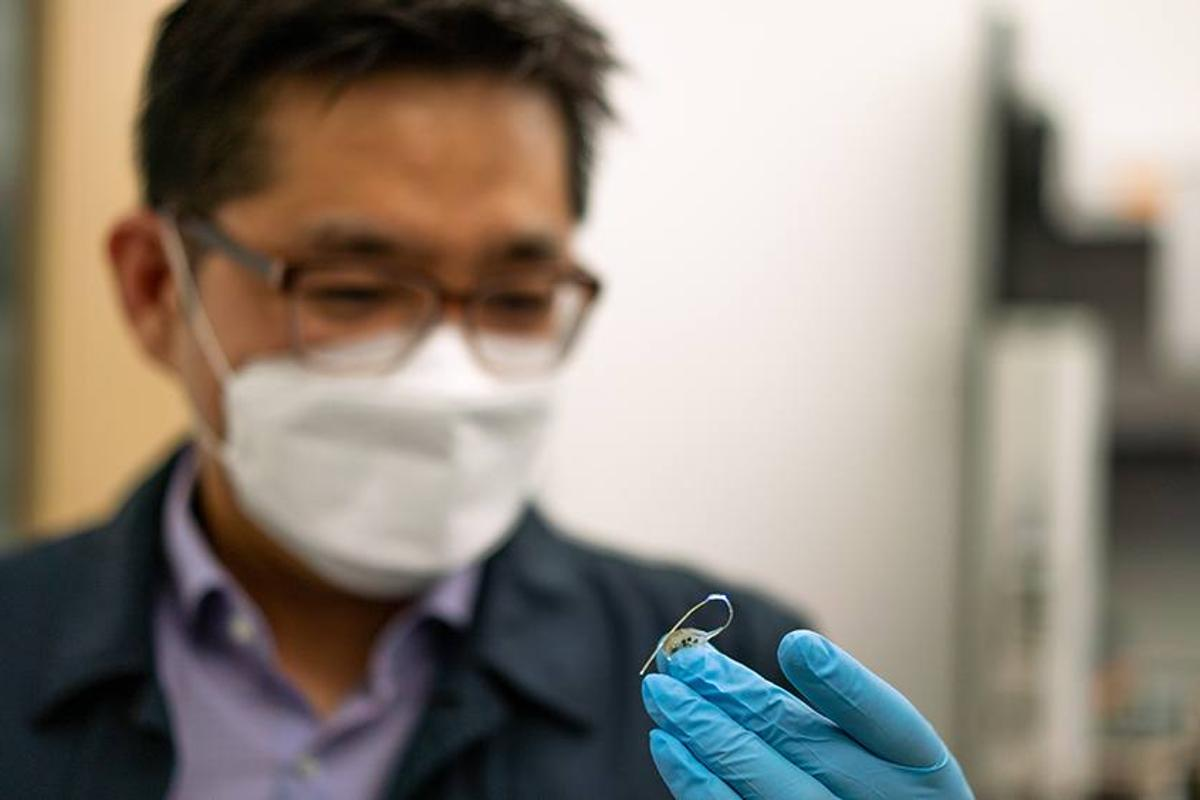 Asst. Prof. Sung Il Park with the prototype implant