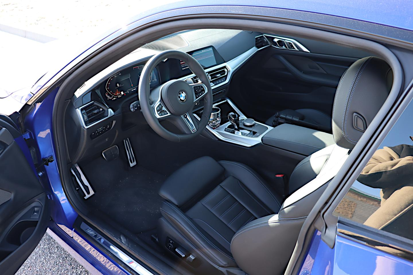 The interior of the 2021 BMW 4 Series is driver-centric and sport focused