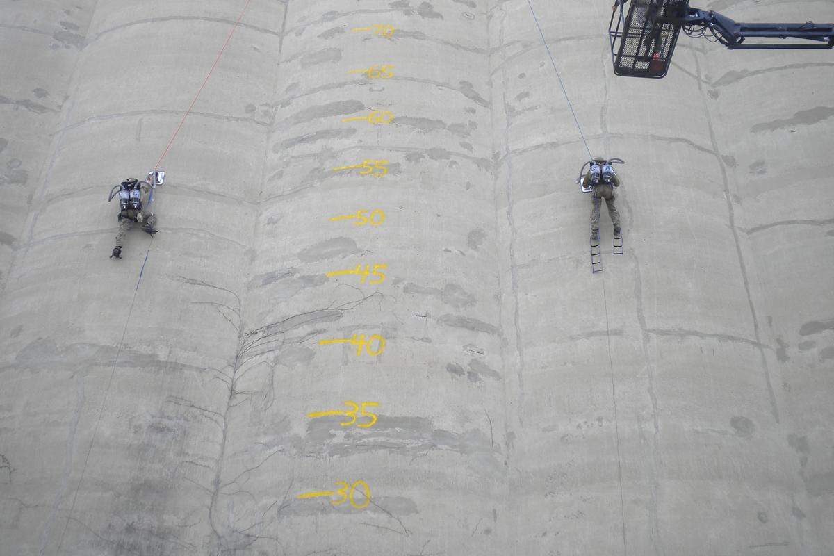 Two climbers ascend a silo, using Utah State University's PVAC system (Photo: USU)