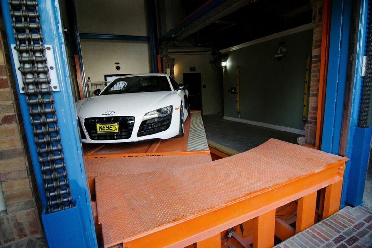 After a driver pulls into the Auto Parkit valet area, all cars are rotated on a turntable 180 degrees before storage