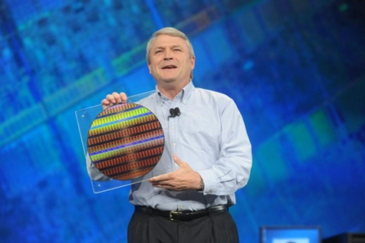 Bob Baker, VP of technology and manufacturing displays a silicon wafer containing the world's first working chips built on 22nm manufacturing technology.