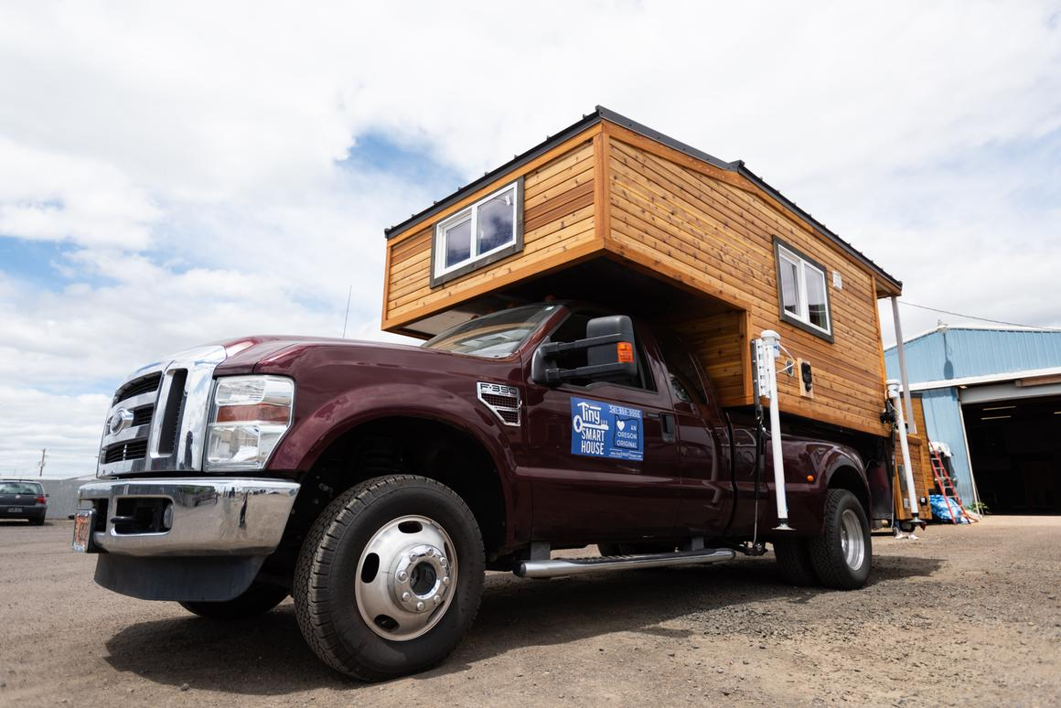 The Tiny Traveler has both a standard RV-style electric hookup and a solar panel system