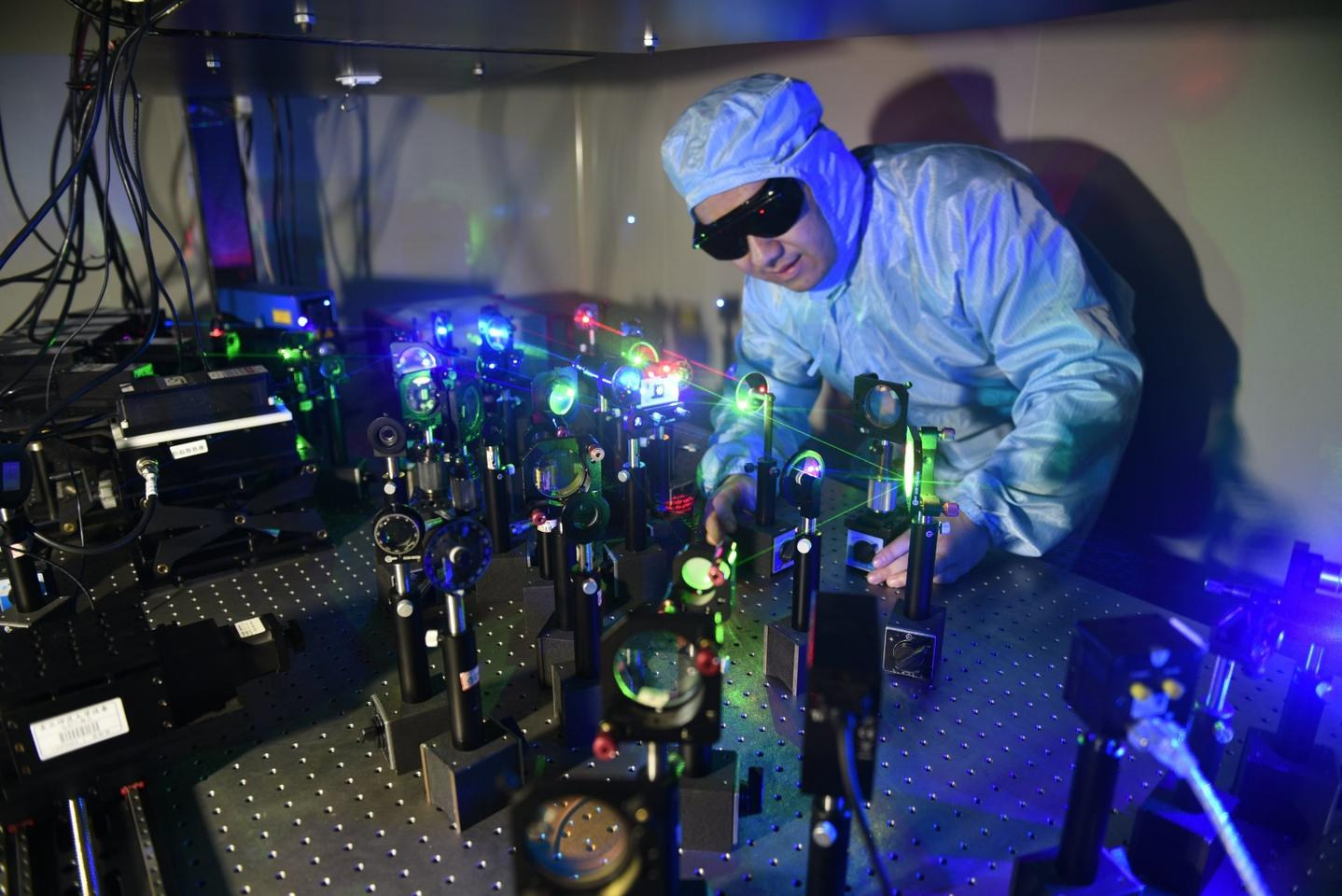 Lead researcher Shencheng Fu conducts experiments on a new film that can store data as 3D holograms