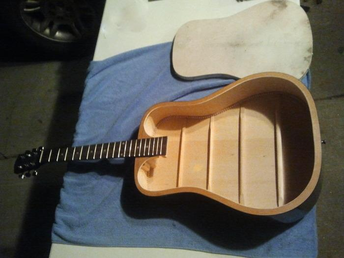 The donor guitar had its soundboard removed, and structural changes were made to the inside
