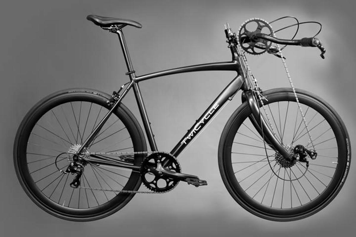 The TwiCycle has a chain running directly from the revolving handlebars to a derailleur and cassette mounted on the front wheel