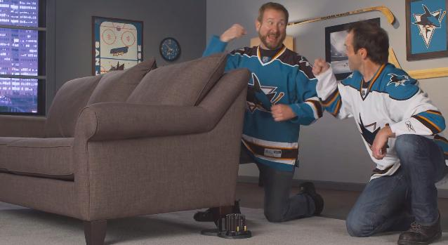Gleeful Sharks fans install the Buttkicker Advance unit under their couch