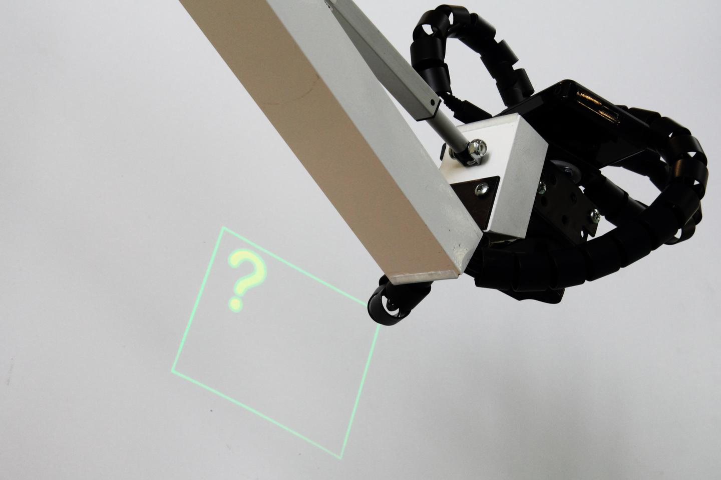 The IBM MRO prototype features a small projector mounted on a robotic arm (Photo: IBM)