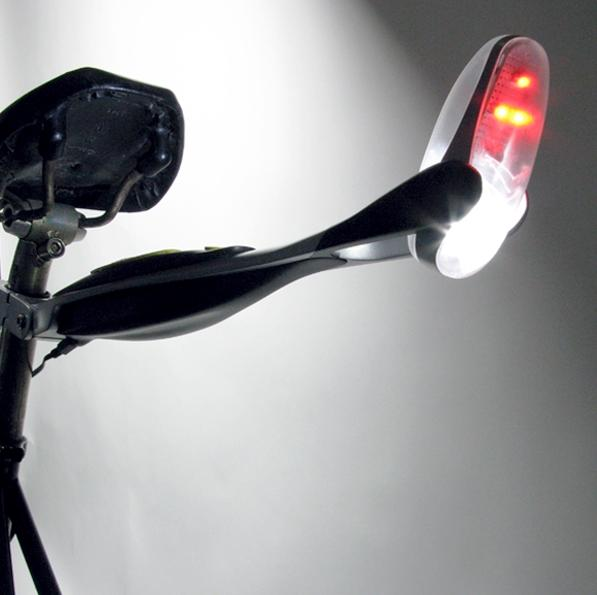 The Firefly bicycle light shines brightly on cyclists' backs and the road beneath their wheels when traffic approaches to provide greater visibility to motorists