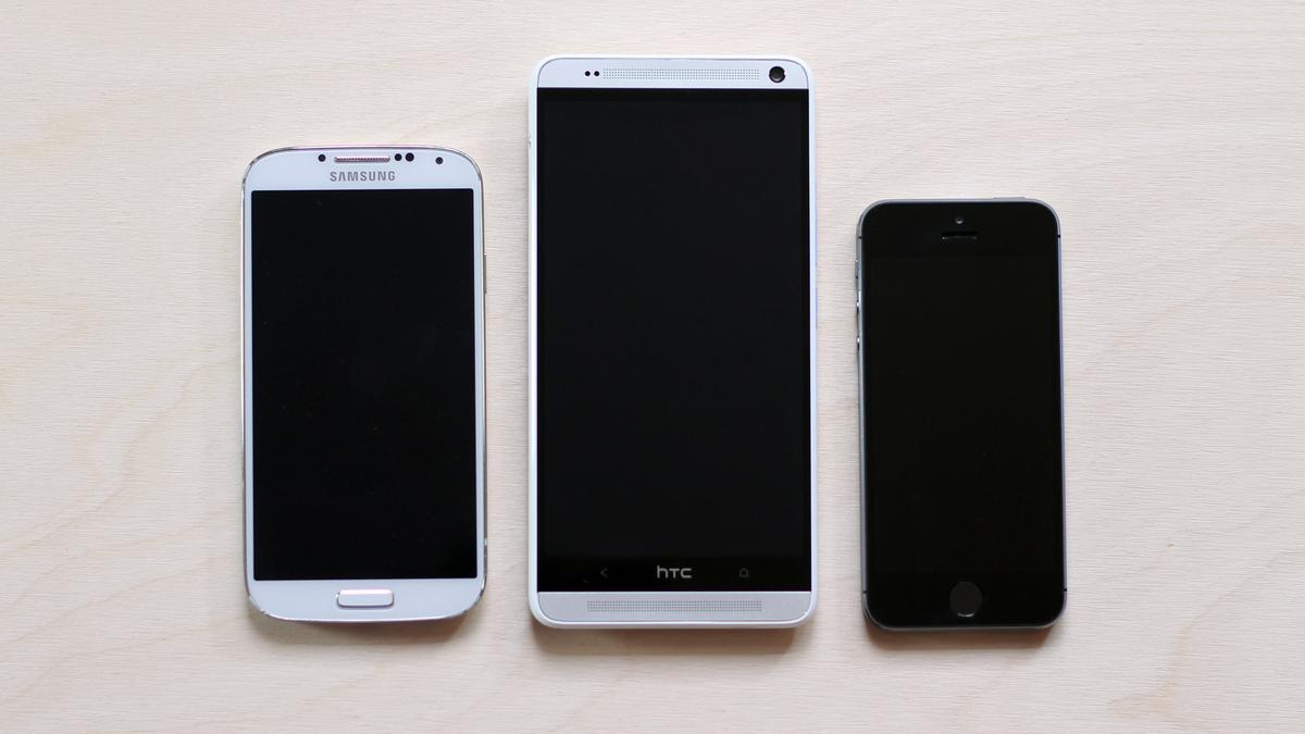 The One max towers over the Galaxy S4 (left) and iPhone 5s