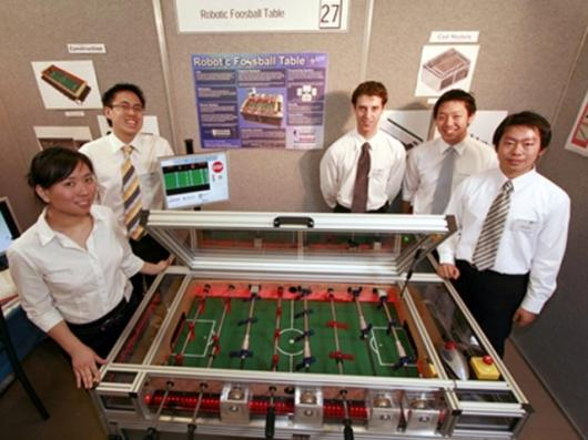 The student team responsible for the automated foosball table (left to right): Tammy Chau, Jason Then, Matthew Turnbull, Sam Wan, Steven Cheng.
