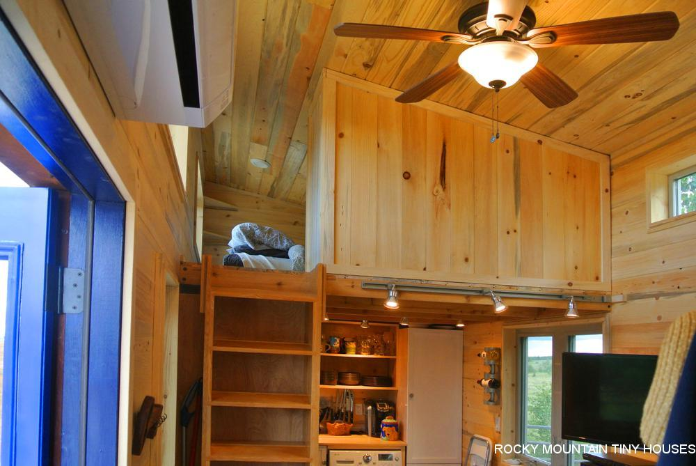 TheRusted Mountain Roost's guest bedroom is accessed by ladder