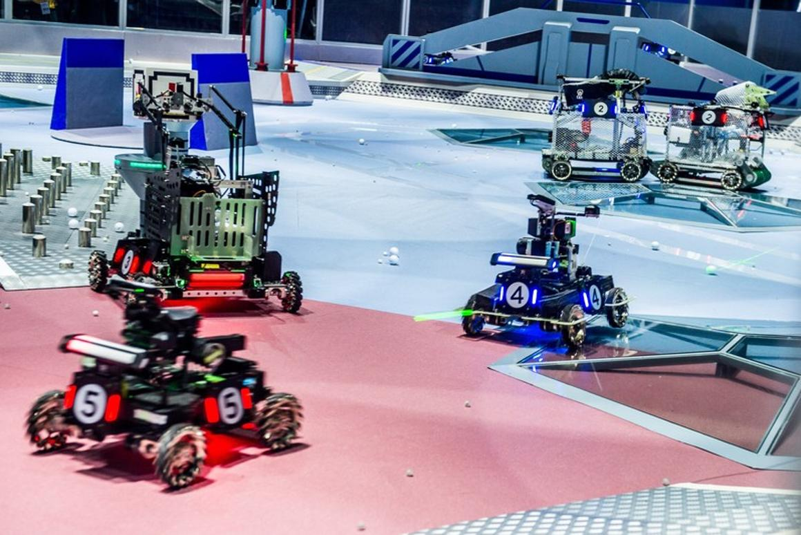 The object of a RoboMaster battle is to take out an enemy base using five types of robot, including battle bots, drones and an armed base station