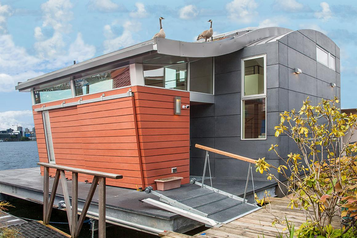Houseboat H features both a roof-based solar array and a green roof section