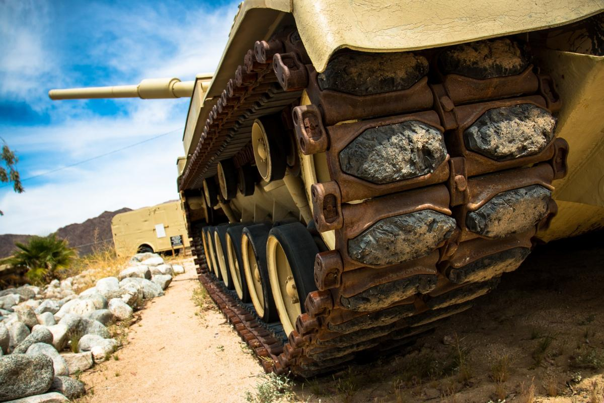 On these tracks with rubber shoes with only 18 inches of ground clearance, the M60 Patton Tank was capable of a vertical 49 inch obstacle climb and fording waters as deep as 48 inches.