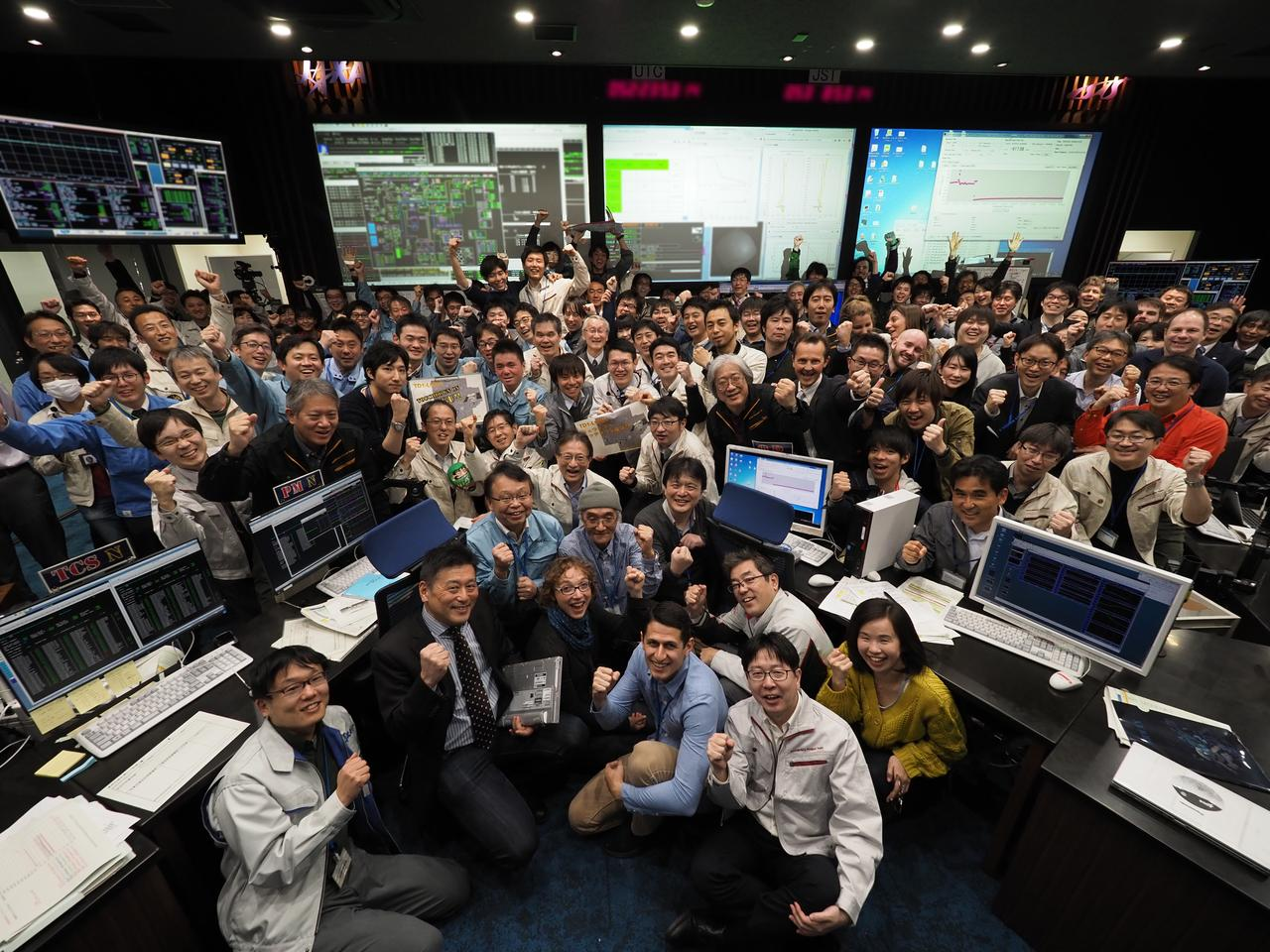 Scientists celebrate at JAXA following the touchdown of Hayabusa 2
