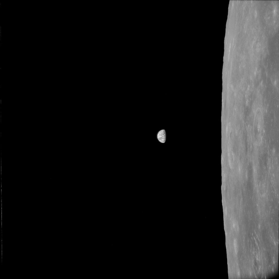 Processed Hasselblad footage of the Earth hanging over the lunar surface as captured during the historic Apollo 11 mission
