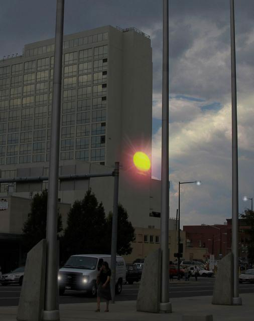 Adam Frank's SUNLIGHT rising up the side of Denver's Minoru Yasui Building