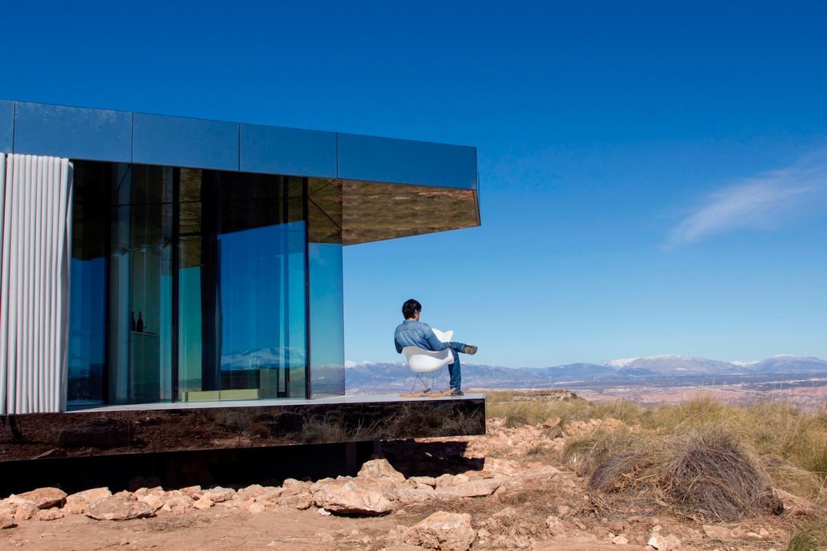The Glass House offers its occupants amazing views of the rugged desert-like Spanish landscape