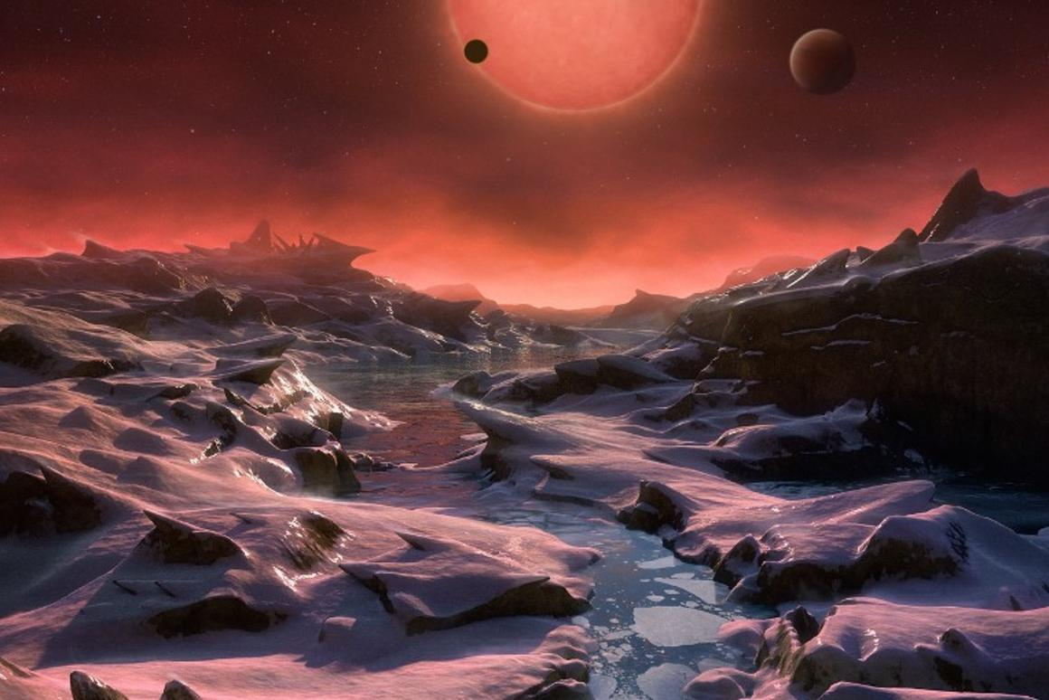 Artist's impression of the ultracool dwarf star TRAPPIST-1 from the surface of one of the three exoplanets found orbiting it