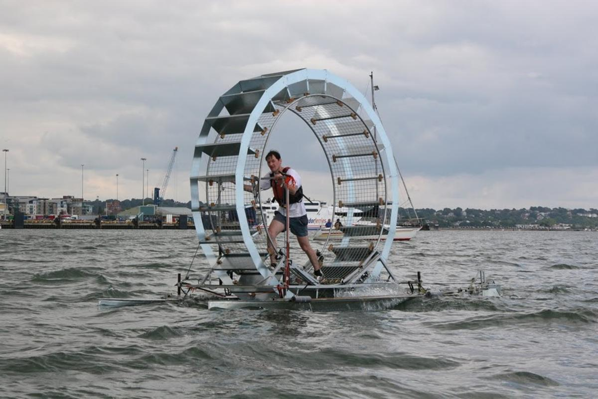 """Thirty-five year old Chris Todd has attempted to """"walk"""" across 106 kilometers (66 miles) of open sea in a giant hamster wheel-like raft dubbed Tredalo"""