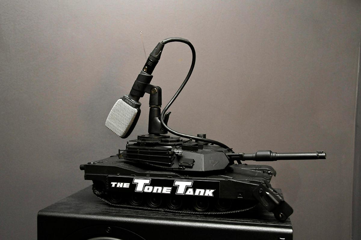 The Tone Tank is an armed, motorized tank sporting a microphone adapter for remote-controlled precision positioning of studio mics