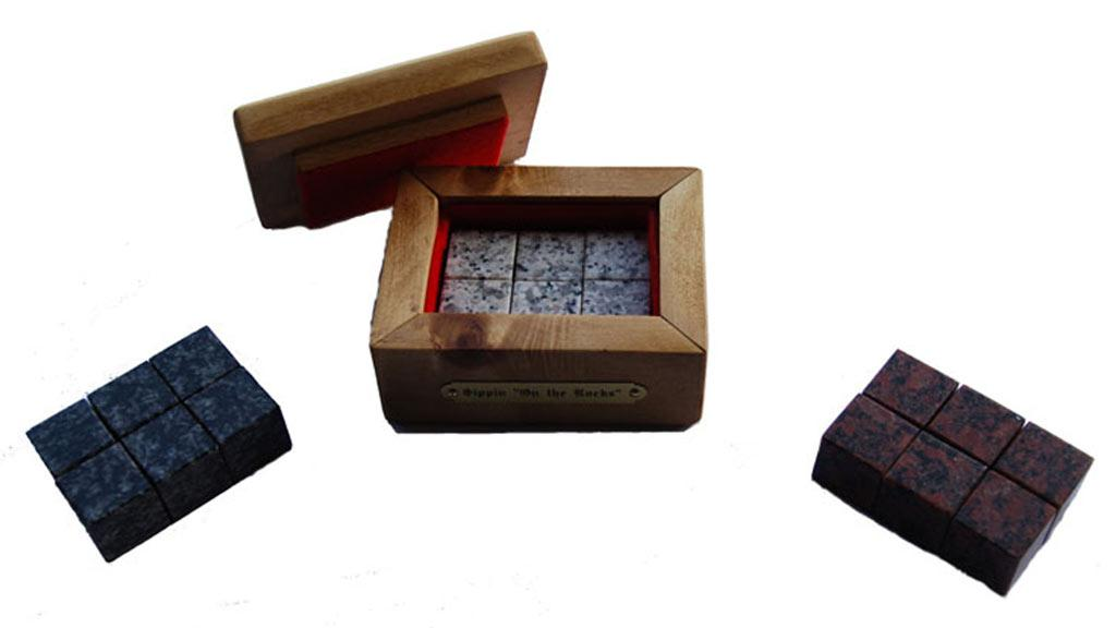 The set of six granite Sippin' Rocks housed in their wooden box