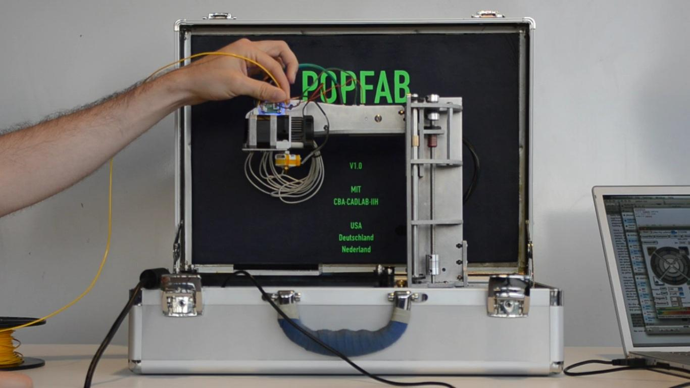 Two MIT students recently developed the PopFab, a machine that does 3D printing, milling, vinyl cutting, and drawing, all while fitting inside a small suitcase