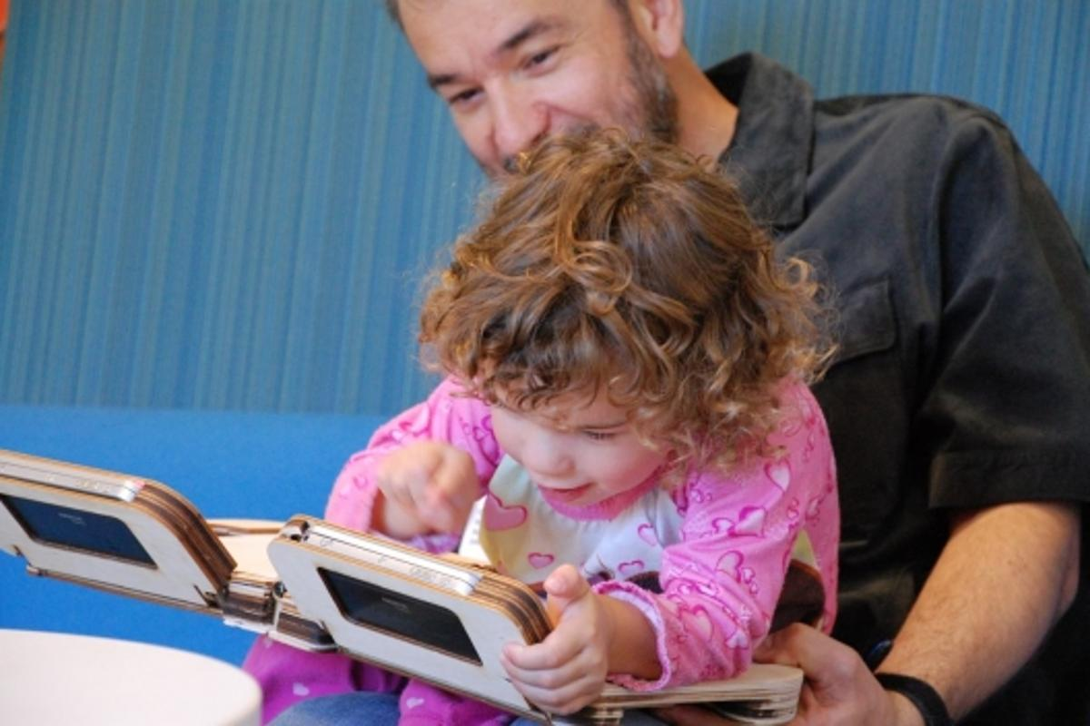 Parent and child enjoying the Storybook experience