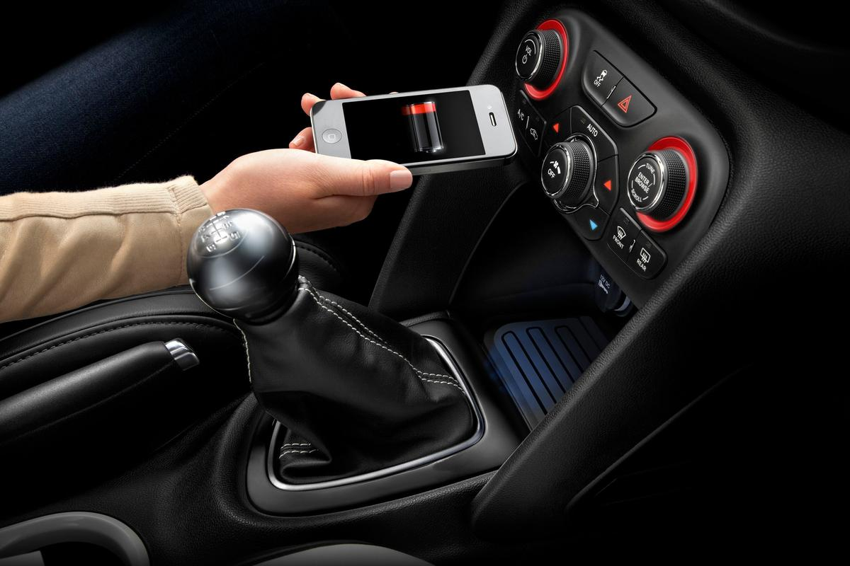 Chrysler's Mopar Division has revealed an in-vehicle wireless charging system for mobile devices that's set to make its debut in the 2013 Dodge Dart later this year
