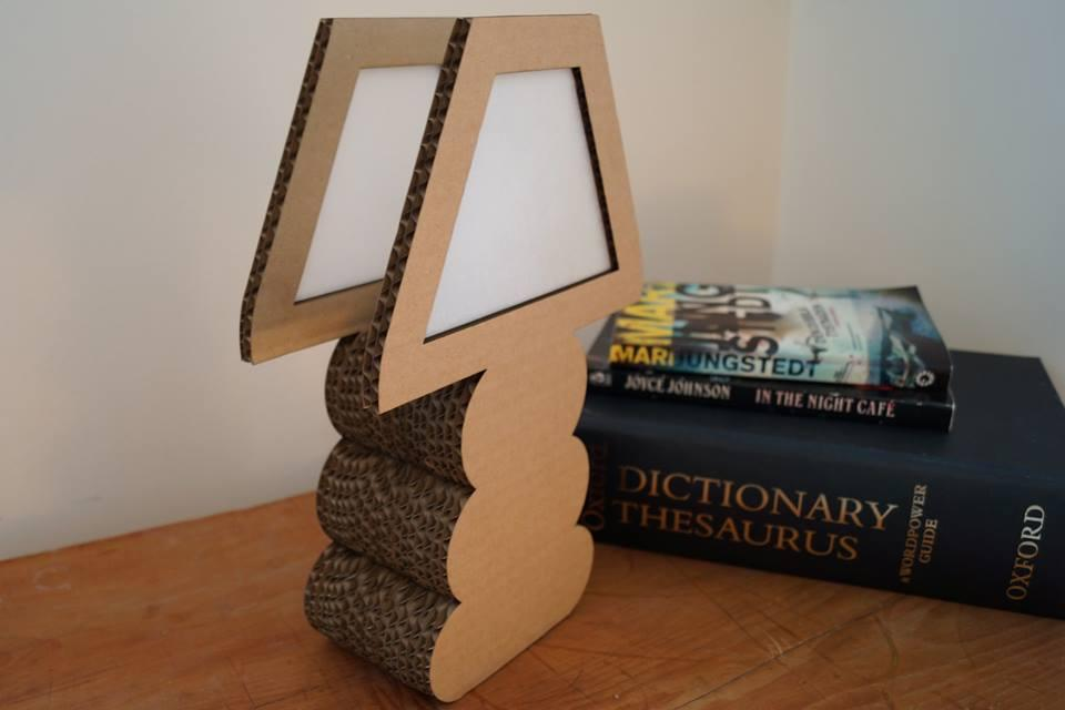 The Cover Lamp is a two-dimensional replica of a typical table lamp made from cardboard boxes retrieved from local stores