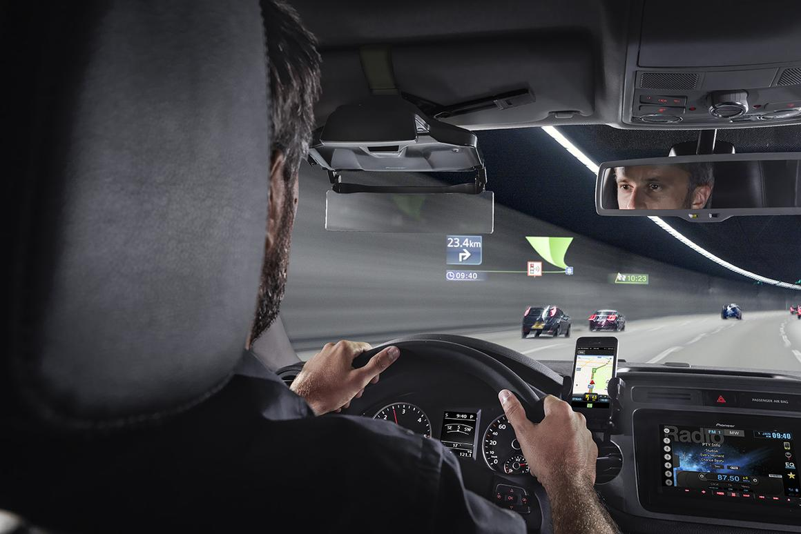 Pioneer's Navgate HUD connected to a smartphone, projecting onto a windscreen