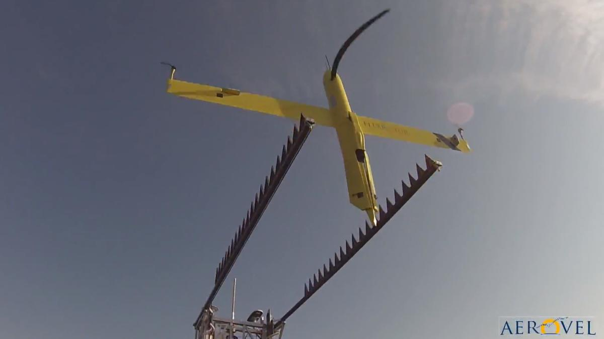 The Flexrotor taking off for its second flight after refueling - the propeller appears bent due to the camera's rolling shutter