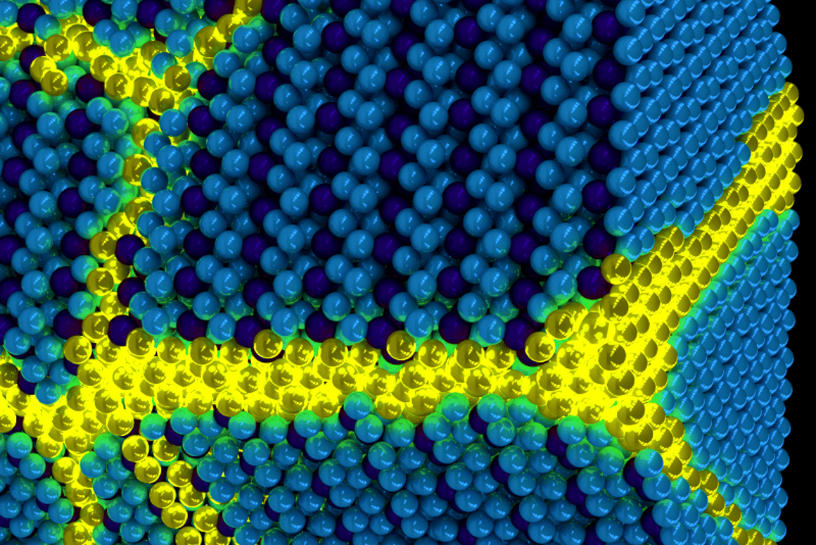 An artist's rendition of excitonium, made up of excitations (yellow) moving through an otherwise ordered solidexciton background