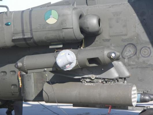 The small pod containing Northrop Grumman's laser Directional Infrared Countermeasures (DIRCM) system mounts to the end of the stub-wing on the Apache AH-64D attack helicopter. The system successfully thwarted a series of simulated heat-seeking missile at