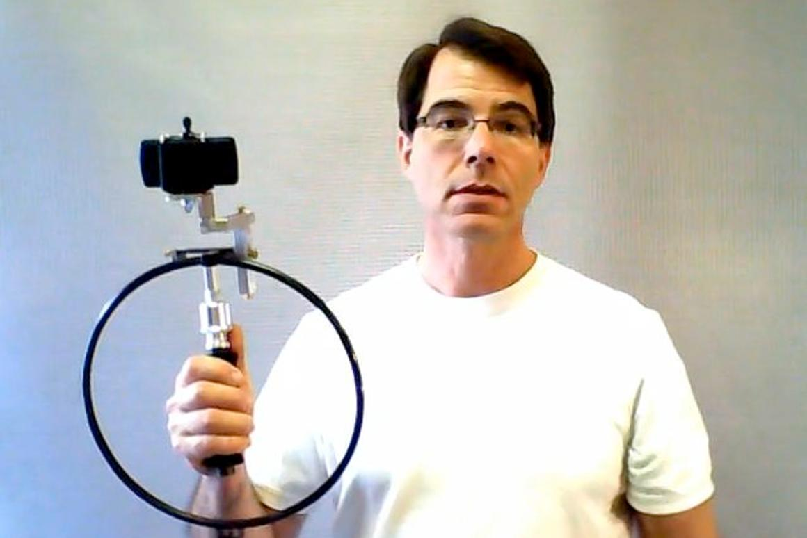 Inventor Peter Homer with a prototype Circle Thing