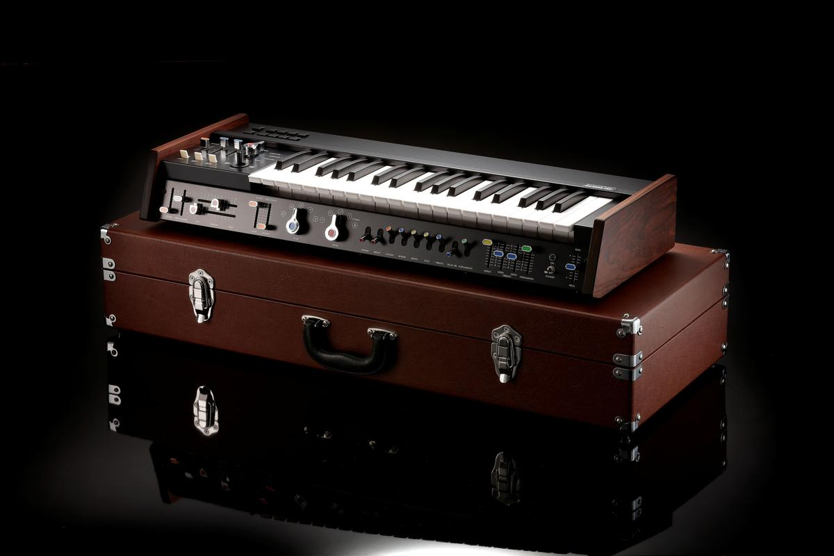 The miniKorg 700FS can sit above a stage piano or organ to run off extra leads or thick bass, but here it rests on its included carry case