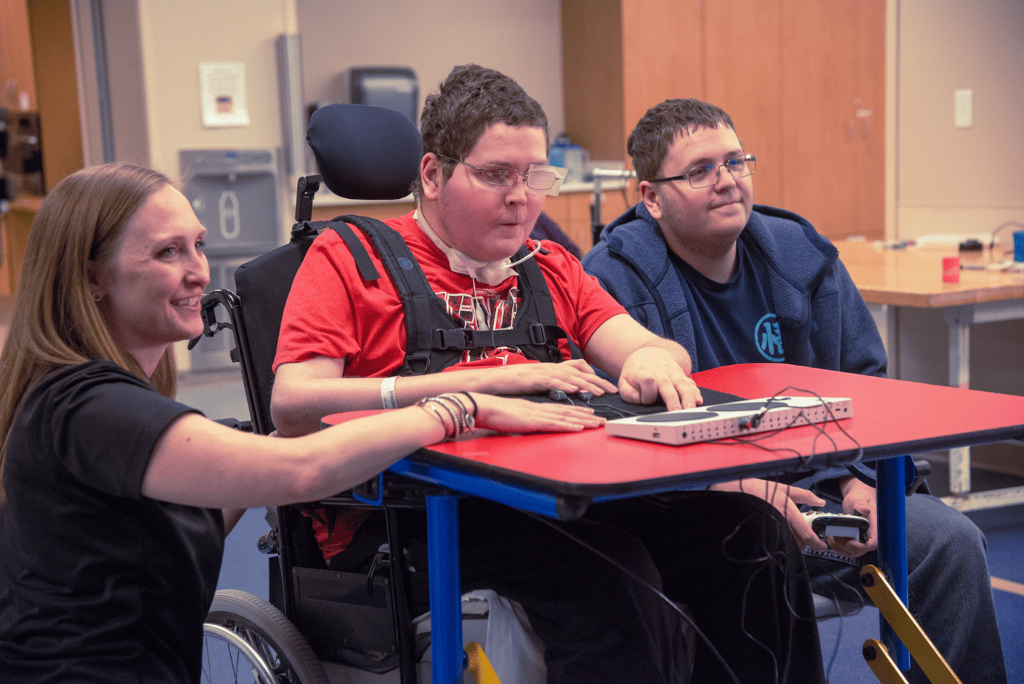A patient with cerebral palsy plays a game using the Xbox Adaptive Controller