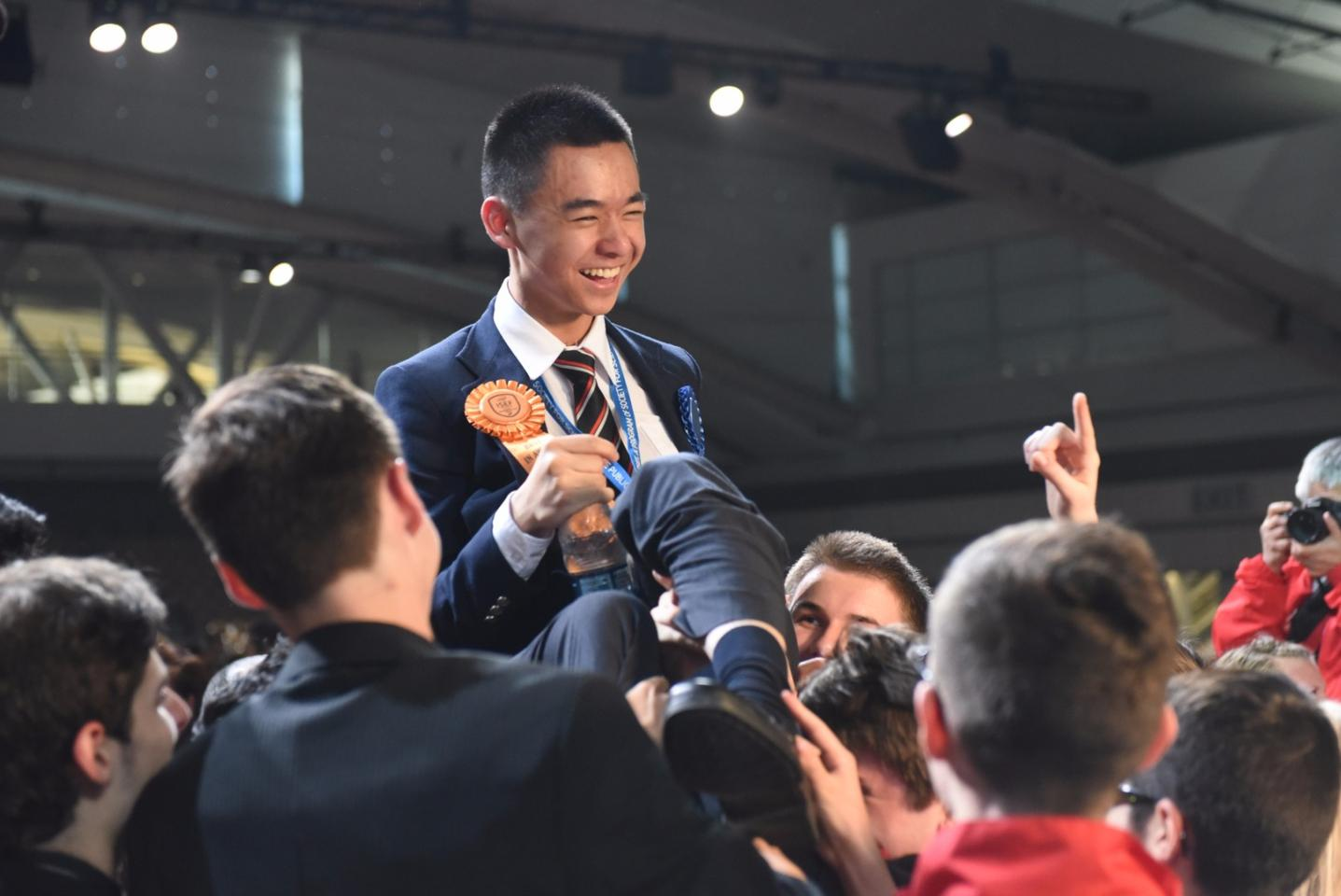 Raymond Wang, the 17-year-old Canadian first place winner at the 2015 Intel International Science and Engineering Fair, celebrates among his fellow finalists