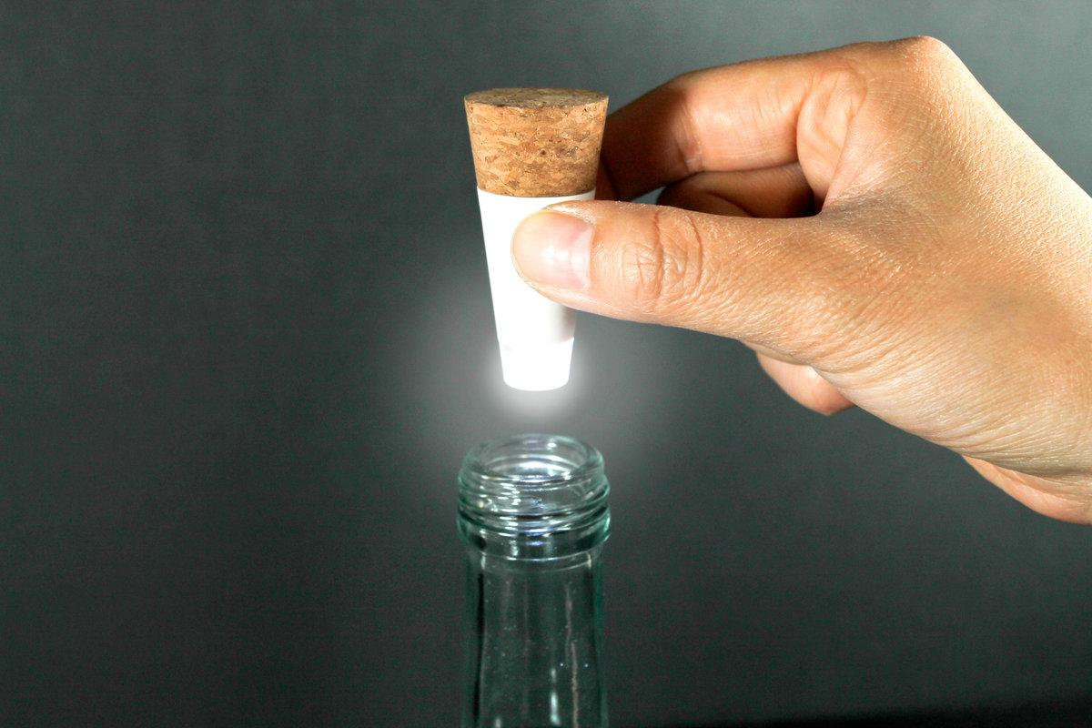 You twist the LED to turn it on, then stick the bottlelight in the top of a wine bottle