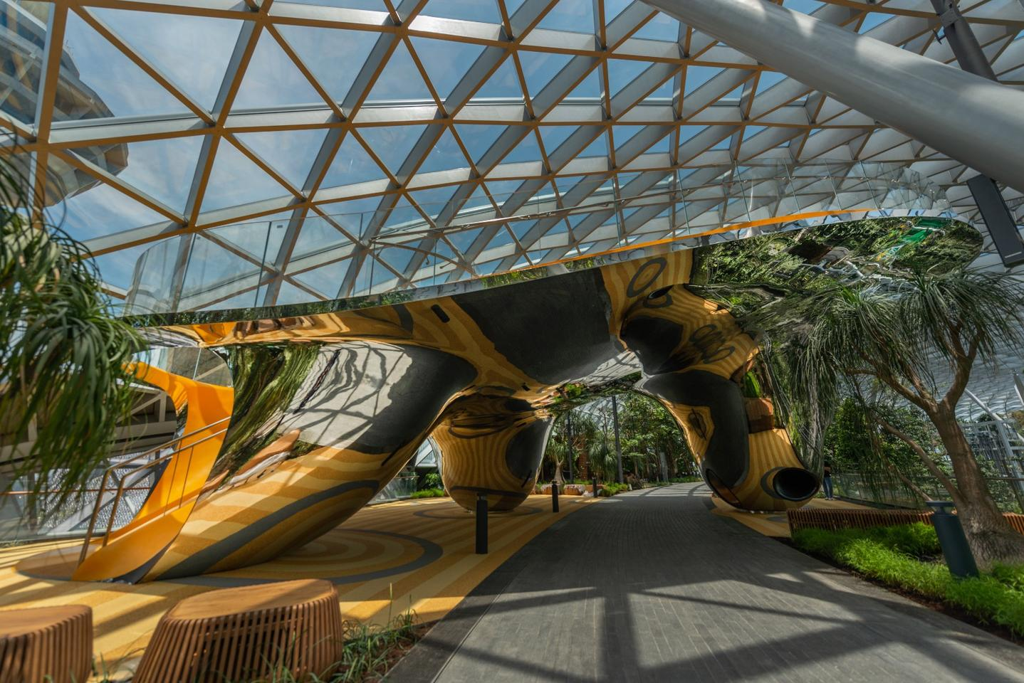 Jewel Changi Airport'sslides are locatedwithin a reflectiveart installation