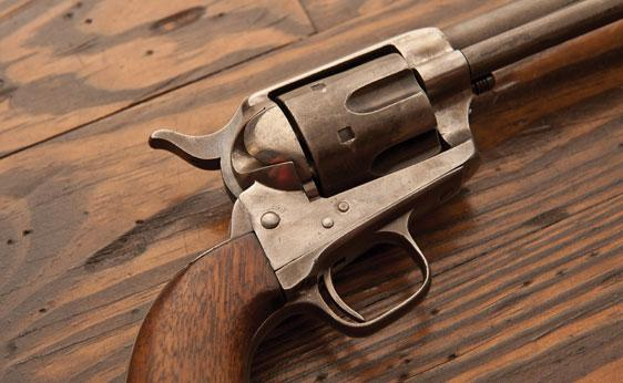 Colt Single Action Army Revolver 1874. This example was in the fifth lot received from Colt to the U.S. Government and has been rebuilt by modifying the barrel length to 5.5 in., possibly for either the Spanish American War or the Philippine Insurrection. It features a six round cylinder with a three screw frame and walnut grips. Expected to bring US$6,500-9,500.