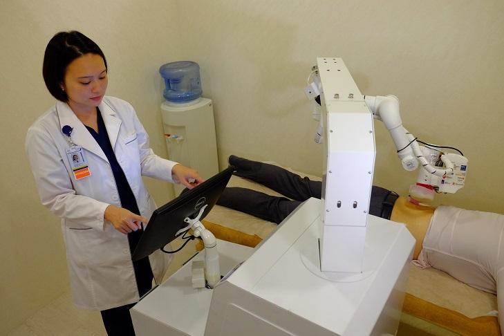 Emma tends to a patient, as instructed by a human user