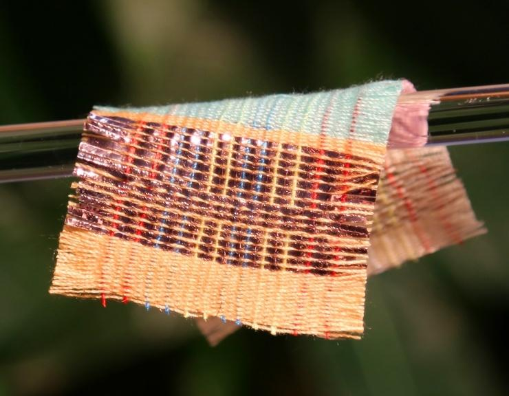 Researchers at Georgia Tech have developed a fabric that can harvest energy from the sun and movement at the same time