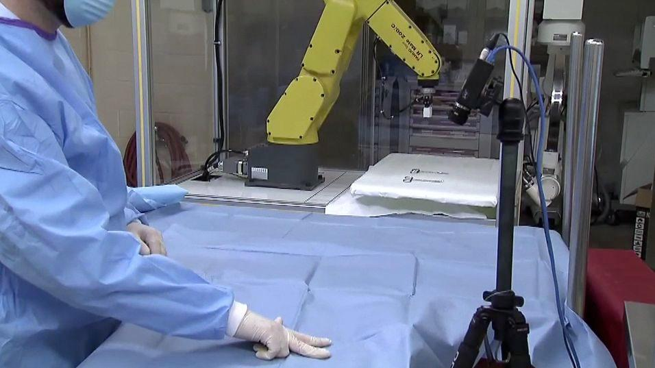 Researchers are developing a system that would allow surgeons to control both computers and robotic scrub nurses via hand gestures (Photo: Purdue University)