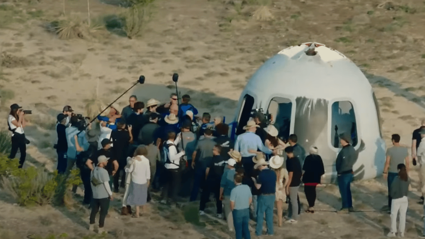 The New Shepard crew exit the capsule after New Shepard's first human flight to space