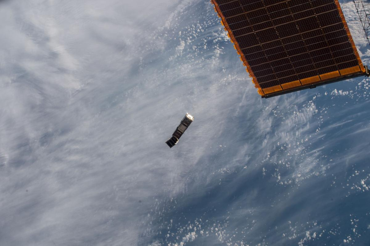 ESA's GomX-3 CubeSat plus the smaller student-built AAUSat-5 being deployed from the ISS