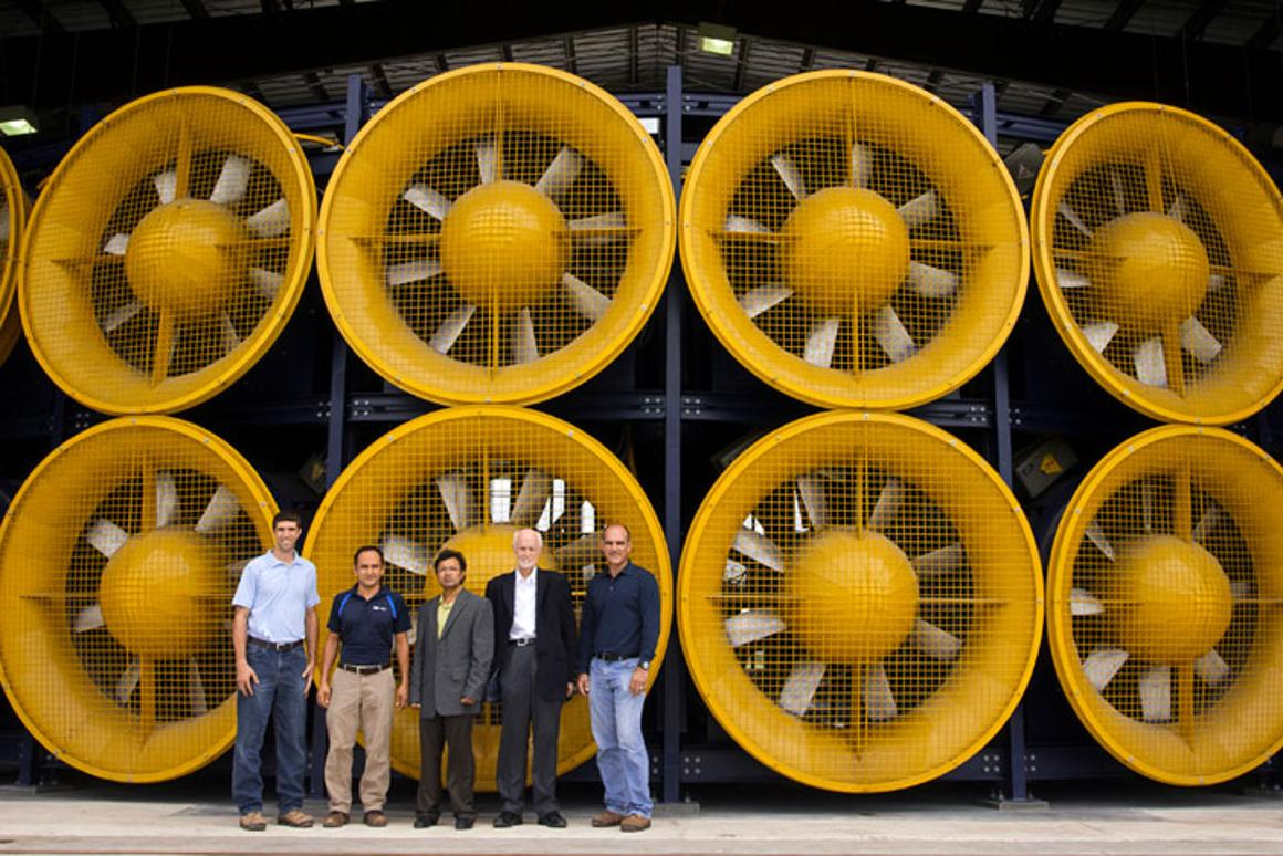 FIU's wind engineering team poses in front of the Wall of Wind