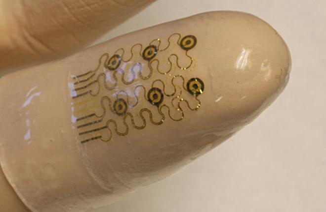 A newly-developed electronic finger cuff could lead to smarter surgical gloves that make performing surgery and scans as easy as pointing your finger (Image: John Rogers/University of Illinois)