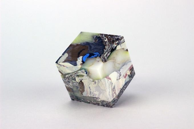 A 1.5-inch cube of dense plastic made from recycled garbage bags that underwent Zufelt's process