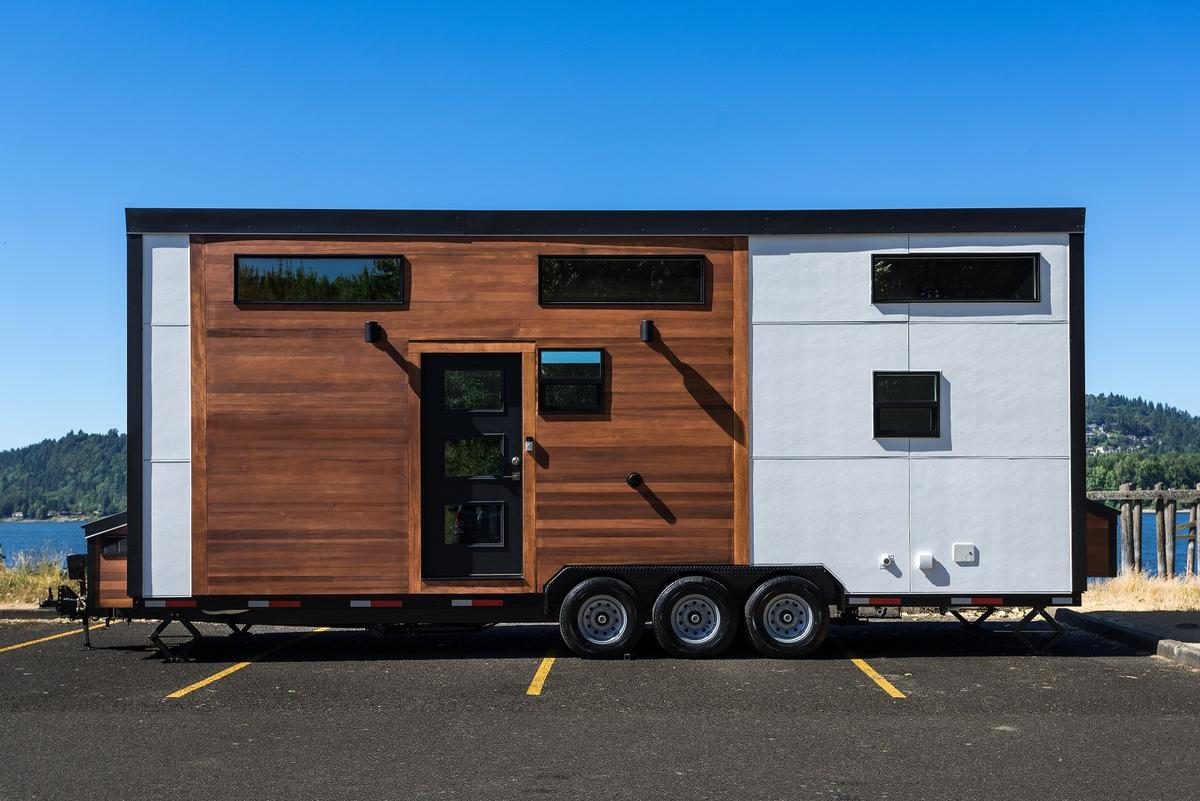 The Catalina is wrappedin board and batten or lap siding, with knotty cedar tongue and groove accenting